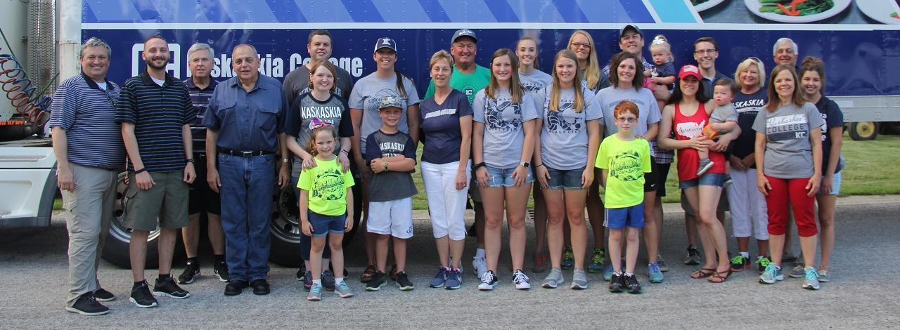 Kaskaskia College staff, faculty and students standing in front of a college tractor trailer prior to Albers 4th of July parade.