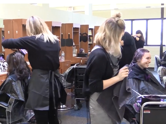 Cosmetology students working with hair