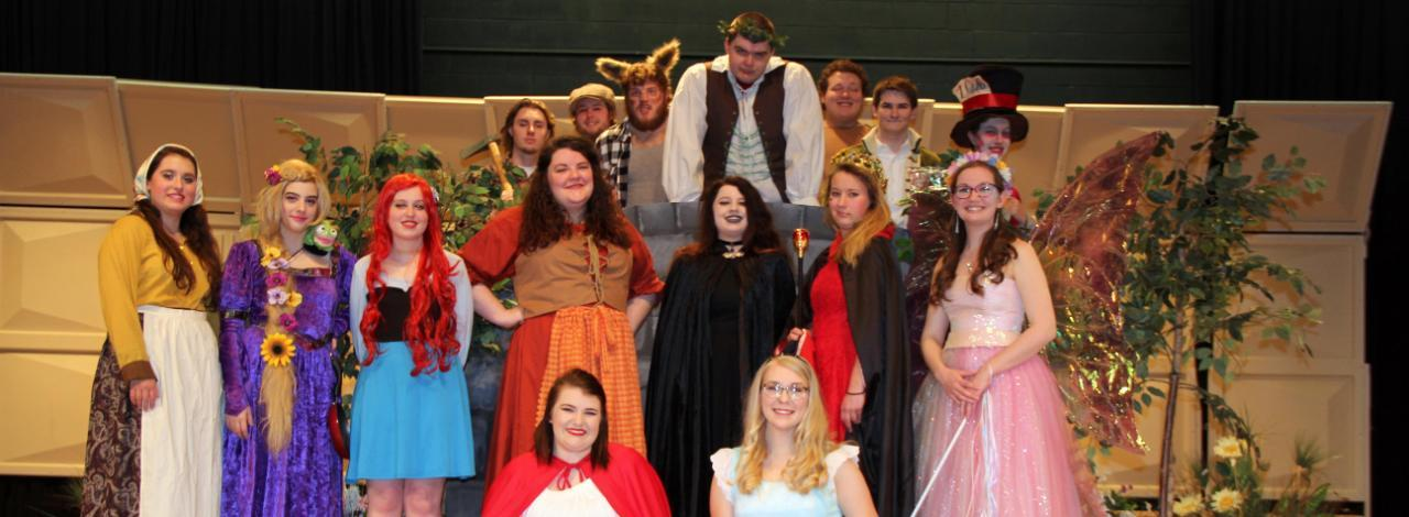 Theatre students posing in costume for spring play production.