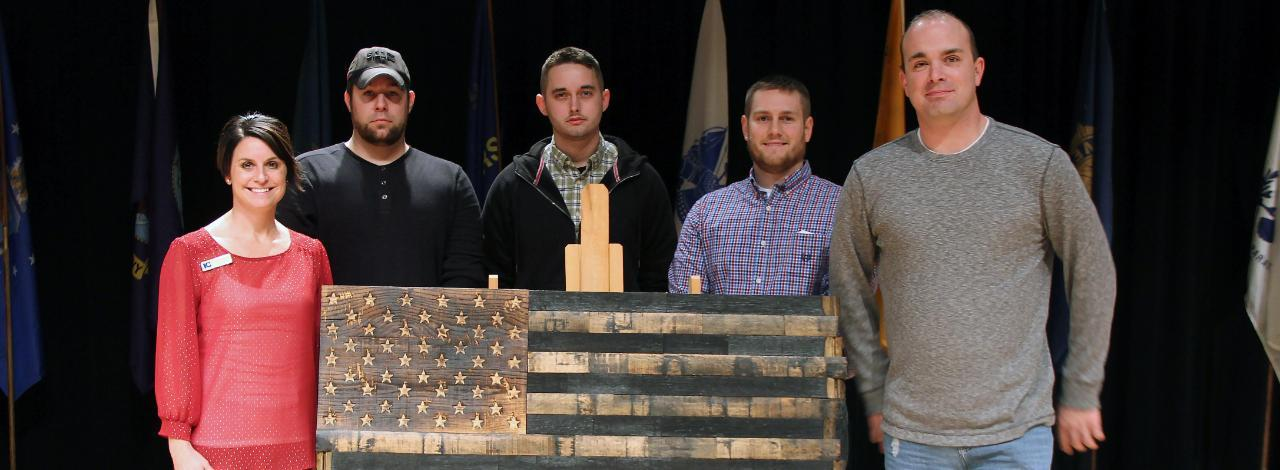 Students with wooden American flag