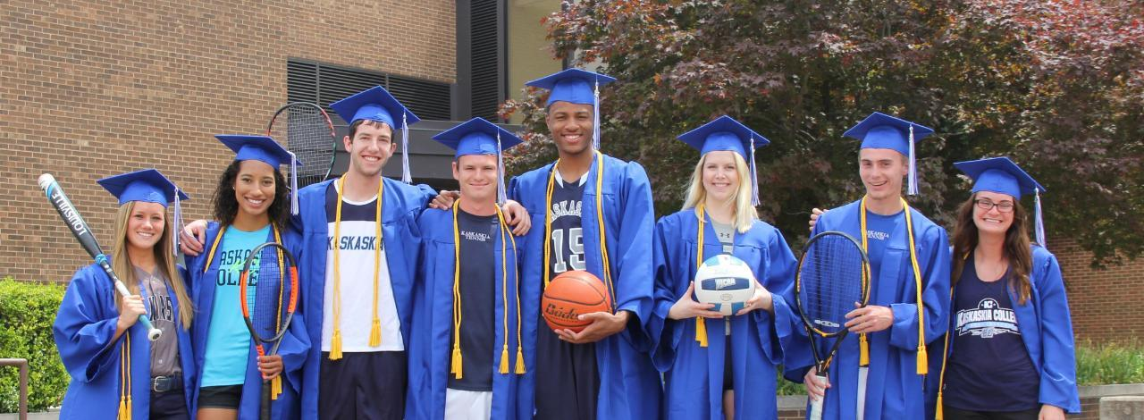 KC athletes representing their respective sports while wearing their graduation caps and gowns.